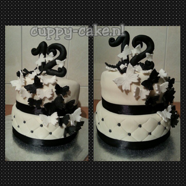 Populair black and #white #birthdaycake with #rainbow #cake inside #zwart &WN32