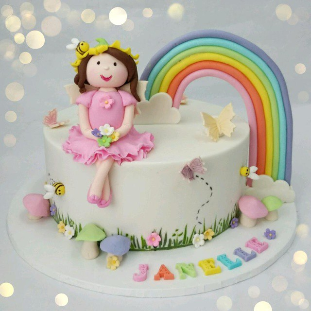 Garden Fairy Themed Birthday Cake In Pretty Pastel Colors For A 1st
